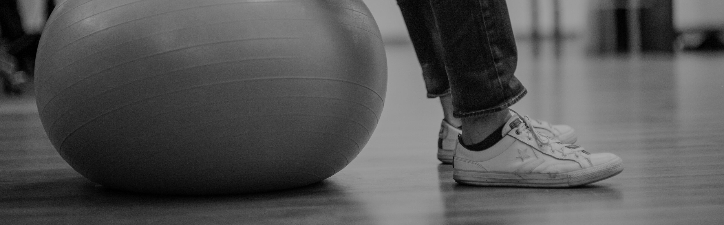 Man sitting on the exercise fitball